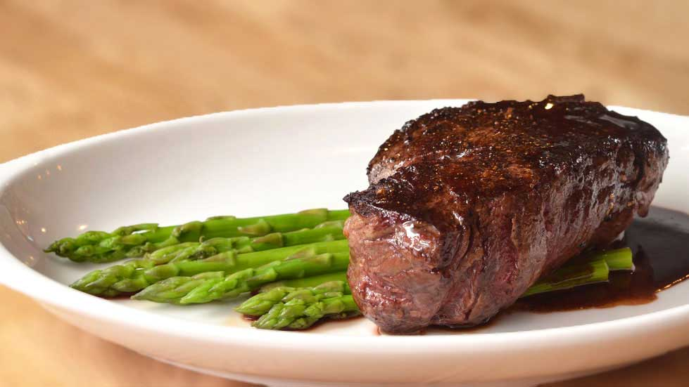 steak and asparagus on plate