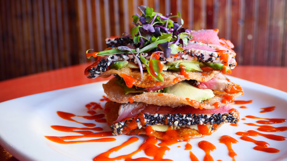 Sesame crusted tuna stack, topped with greens
